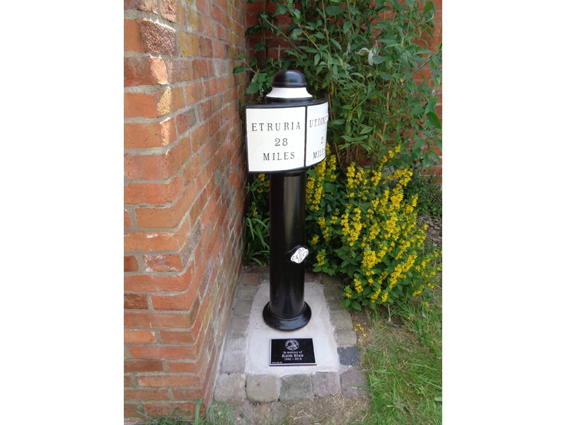 Milepost 28 with dedication plaque